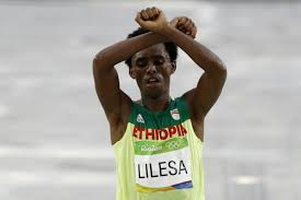 Ethiopian marathoner who made Rio protest returns from exile