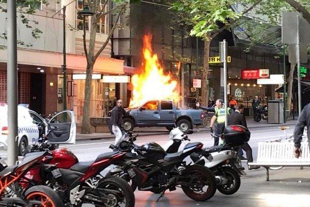Watch: Terrorist attack in Melbourne, knife-wielding man sets truck on fire [video]